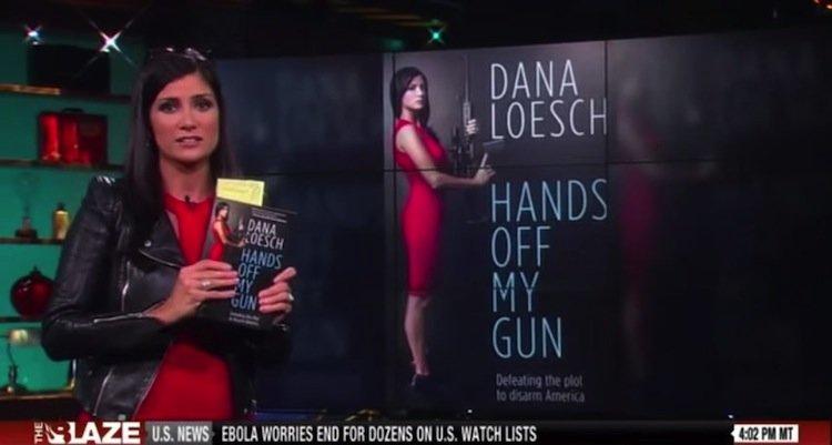 """Dana Loesch holding a copy of her new book, """"Hands off My Gun.""""  (Photo: The Blaze)"""