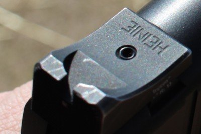 The Heine sight does have a slight ridge on its front edge that allows for one handed manipulation of the slide.