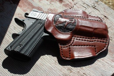 The Nighthawk guns often come with custom holsters. This one has the Nighthawk logo prominently embossed on the front.