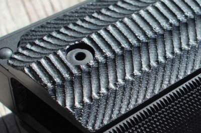 If you like an agressive grip, you'll dig these. The checkering and lines are all precise and well executed, but the grooves in these grips are like a rasp.