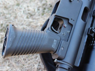 The lower resembles an AR, but the safety is a cross-bolt style.