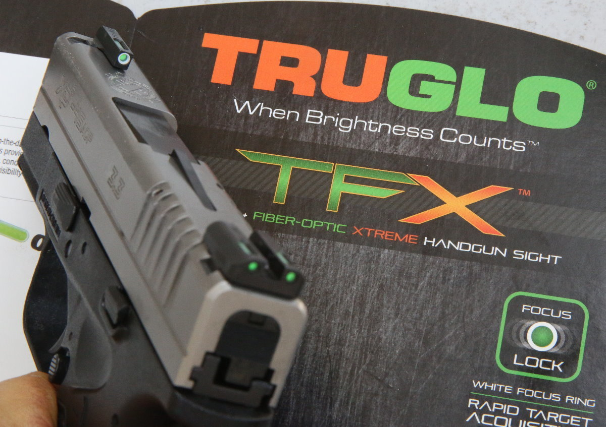 The Truglo TFX is their new tritium night sight. They are glass capsules filled with a glowing radioactive isotope of hydrogen, and they don't need to be charged up by a light source first. They last about 12 years before starting to dim.