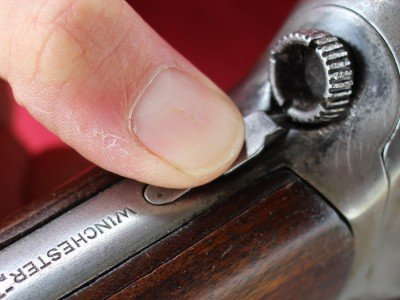 Push the button down and turn the knob to take the stock off the receiver.