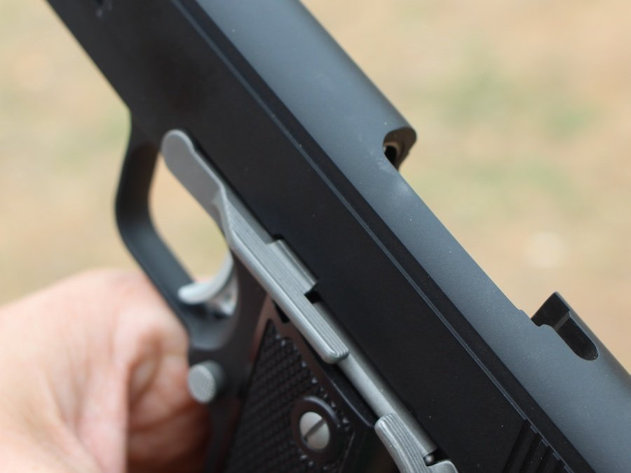 If you're right handed, as most of us are, you have to keep your left thumb clear of the slide stop. If you bump it up, the gun locks open, like this.
