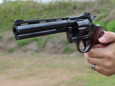 With a revolver, you have to keep your hands clear of the cylinder, and the gases escaping there. So the gun tends to pivot more.