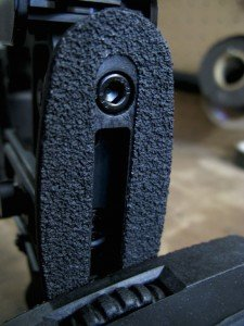There is an extra grippy material used on the stock that helps keeps adjustments glued in place with just a little tension.  The thumbwheel also makes it easy to fit the recoil pad to the shoulder