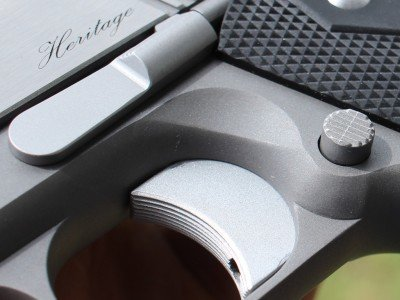 I really like the contracting colors of the stainless on this pistol. The black grips also look nice.