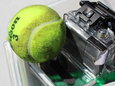 Tennis balls get singed. This one has been shot once.