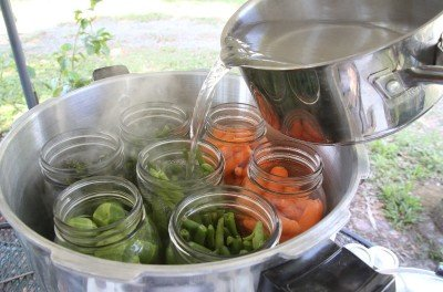 For this article I chose cold pack for veggies. The upside is that you don't have to handle hot glass jars, but you lose a lot of capacity per bottle that you can capture if you cook the veggies a little first. For cold pack you cover with boiling water, then stir to remove air bubbles before capping.