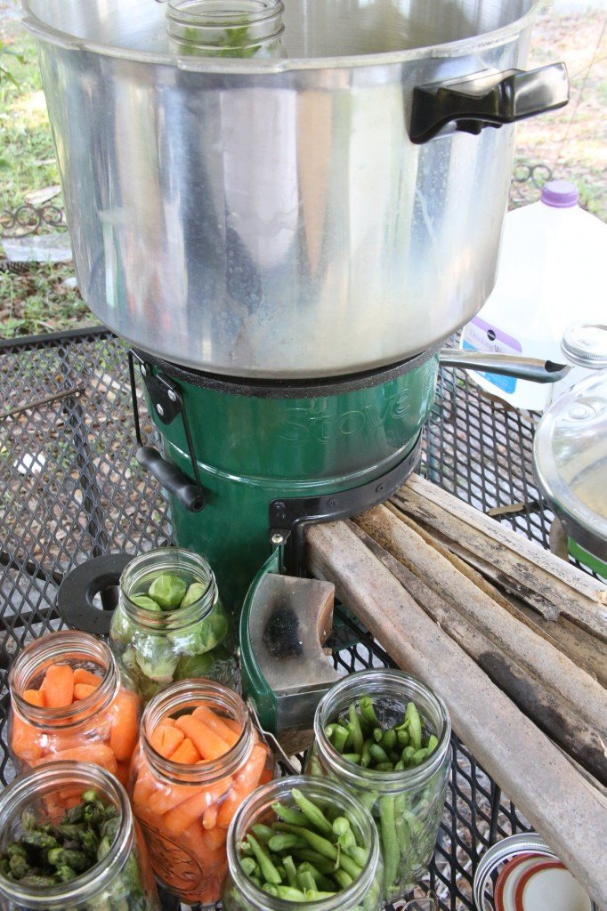 My first shot at canning with my StoveTec Rocket Stove didn't work. As you can see, I didn't attempt to use the heat ring because it didn't fit around the pot, and I stuffed the fuel door with palm fronds, which for normal cooking works great, because you don't want ripfire heat.
