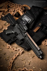 The AR57 upper receiver actually uses the top-mounted FN PS90 magazine and ejects through the lower receiver magazine well.