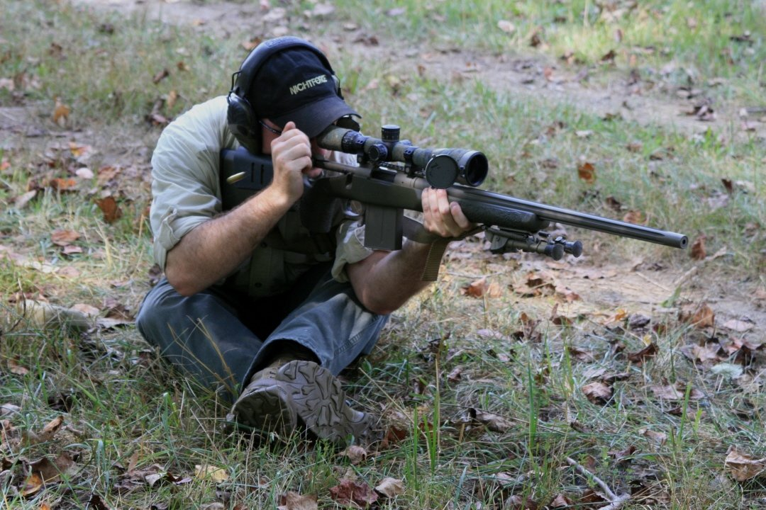 Shooting in alternate positions  such as the sling supported as shown almost require breaking the shot at the natural respiratory for accuracy.  Holding your breath is not the way to go.