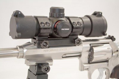 The included red dot optic offers red and green adjustable intensity dots.