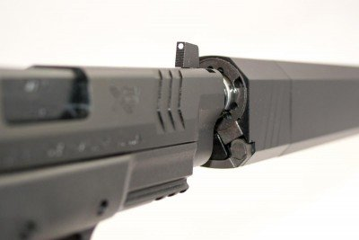 The front sight is plenty tall to clear this SilencerCo Osprey 45 suppressor.