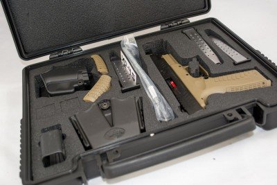 Like most Springfield Armory guns, this one comes in a beautiful hard case, includes three magazines, a holster, magazine carrier and magazine loading tool. It's everything you need except ammo.
