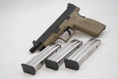 Both 9mm and .45 ACP models come with three magazines. The 9mm mags hold 19 rounds while the .45's hold 13.