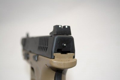 Tall rear sight for suppressor use and the XD(M) cocking indicator.