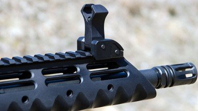 The Diamondhead handguard and flip-up sights are standard equipment. Also shown is the A2 flash hider.
