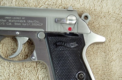 There are no ambidextrous controls for lefties like me. However, I carry with the safety off and have no trouble reaching the magazine eject button with my trigger finger.