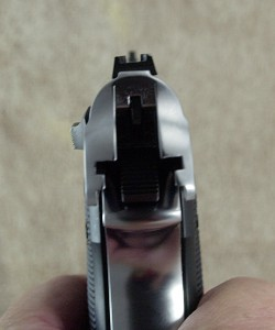 The .22 sight is a simple post up front with a U-shaped rear sight. The rear sight is flat enough to use as a one handed cocking assist on both guns.