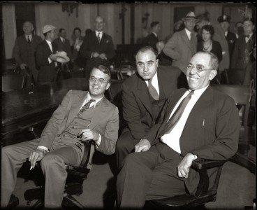 Big Al with his attorneys during his 1931 trial for tax evasion. They were smiling but he went to prison.