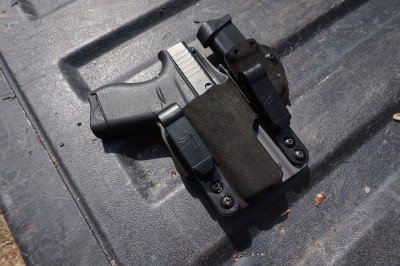 Holsters that incorporate an extra mag offer an easier way to maintain control of extra ammo.