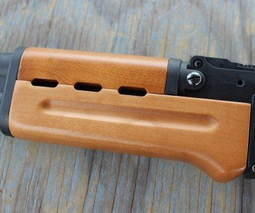 The handguard is wooden, and much easier to get on and off than that or a genuine AK.