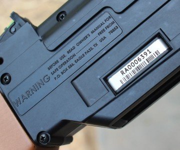 Serial numbers are engarved on a plate secured to the plastic shell.
