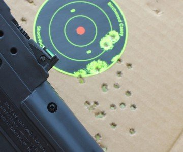 25 yards, standing. The light weight of the gun makes it very easy to hold.