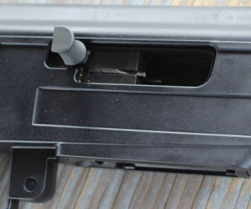 The charging handle is easy to find, and moves the bolt with almost no effort.