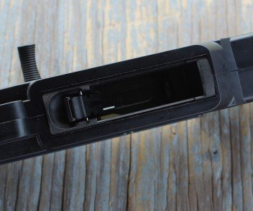 The mag-well is easy to find, and has a thumb latch for the release.