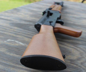 The wooden stock pins into the receiver.