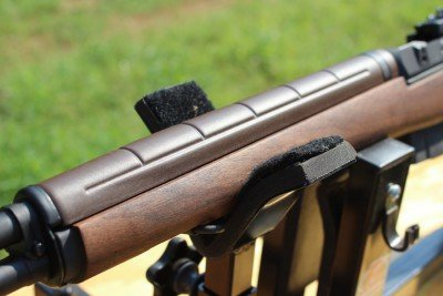 The handguard is plastic and clips onto the barrel.