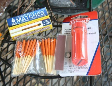 You can get both windproof matches and waterproof match cases at Walmart, or online, and they are cheap. This article is about using a sparker, and using the sun, but don't discount common sense supplies.