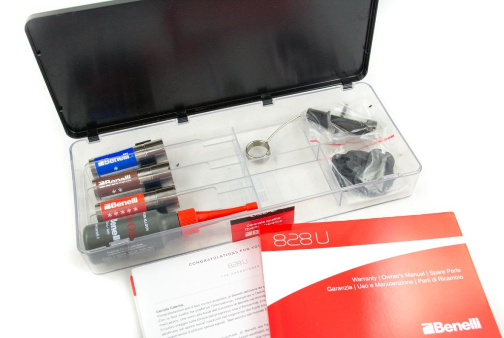 The plastic box inside of the hard case includes extra choke tubes, gun oil, choke wrench, shims and documentation.