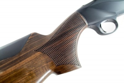 The checkering pattern on the grip and fore-end stock resembles scales - another non-traditional approach.