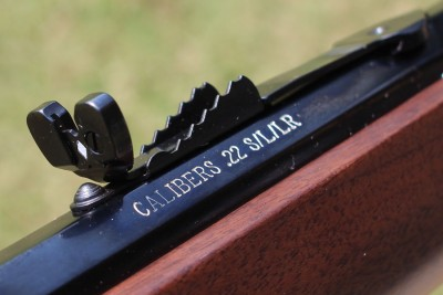 The rear buck-horn sight is adjustable.