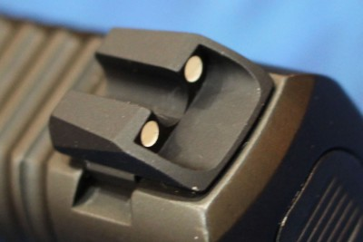 The rear sight is protected by the sight's inset design.