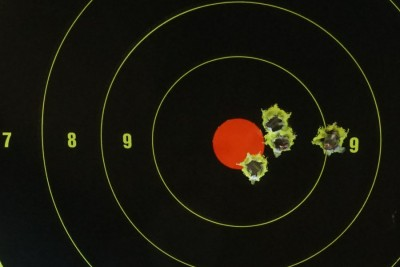 Five shots from 25 yards. Shooting the heavy pistol without the brace isn't impossible, but it can be awkward.