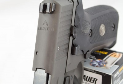 The Legion logo is engraved on the top of the slide just forward of the rear sight.