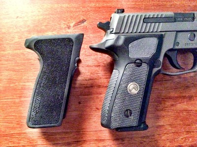 The new G10 grips are ever so slightly larger around than the standard one-piece P229 grips.