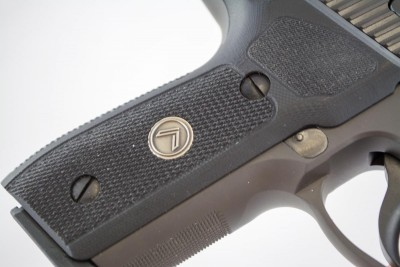 There is an aggressive checkering pattern on the front of the grip.