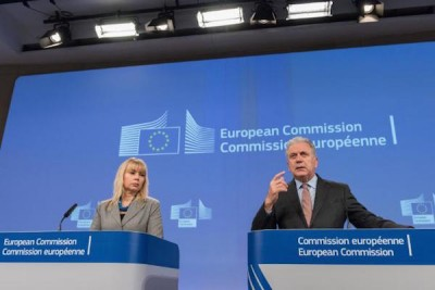"""Internal Market and Industry Commissioner Elżbieta Bieńkowska, on the left and Migration, Home Affairs and Citizenship Commissioner Dimitris Avramopoulos, on the right who said about the gun-control package, """"The adoption of the firearms package today is proof of the Commission's determination to address the new reality we are confronted with. We need to remove regulatory divergences across the EU by imposing stricter, harmonised EU standards for firearms and ensuring efficient exchange of information between Member States."""""""