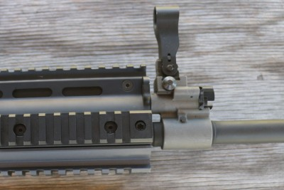 The hooded front sight is built into the gas block.