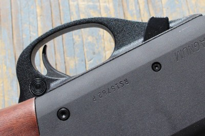 The action bar lock is forward of the trigger guard.