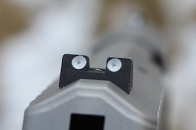 The steel rear sight is adjustable and has a locking screw.
