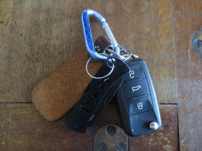 The SOG Micron II on my keychain.  It's heavy enough to notice, but not too heavy where it becomes a pain.