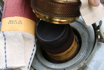 The only removable parts on the Aladdin are the burner ring and that cap in the middle. The wick pushes down over the center draft cylinder, like the Perfection.