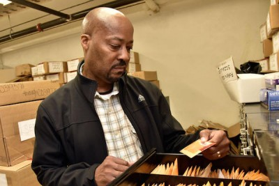 Zach Suber, Maryland State Police forensic scientist supervisor, holds an envelop containing casings in the files at the Maryland State Police Headquarters. (Photo: Kim Hairston, Baltimore Sun)