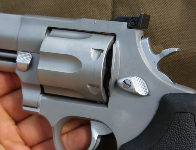 The big revolver has two cylinder lock releases.